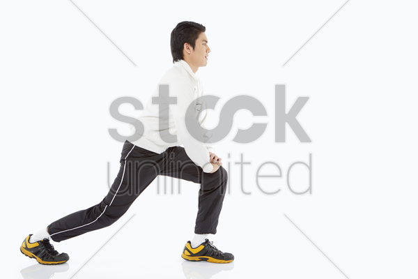man doing lunges, facing right stock photo