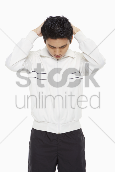 man doing stretches, facing downwards stock photo