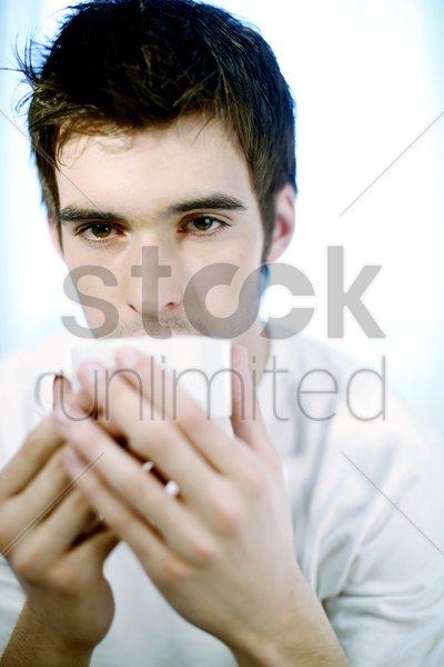 man drinking a cup of coffee stock photo