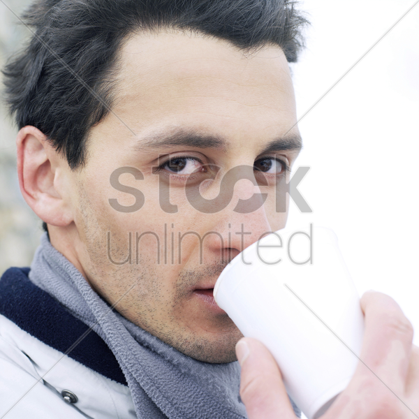 man enjoying a cup of hot drink stock photo