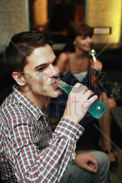 man enjoying his bottled drink stock photo