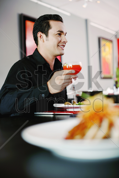 man enjoying his meal in a restaurant stock photo