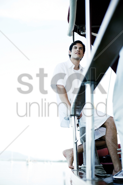 man enjoying the sea view from yacht stock photo