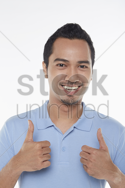 man giving two thumbs up stock photo