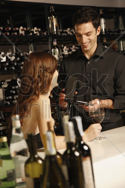 man giving woman present stock photo