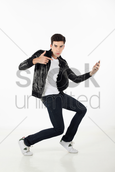 man grooving while listening to music on mp3 player stock photo