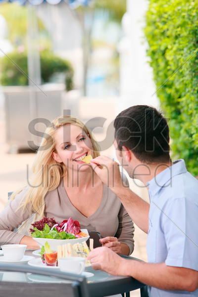 man having a meal at an outdoor restaurant stock photo