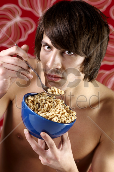 man having cereal breakfast stock photo