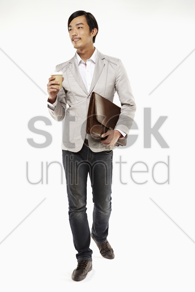 man holding a briefcase and disposable cup stock photo
