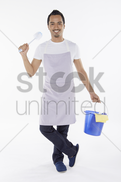 man holding a brush and bucket stock photo