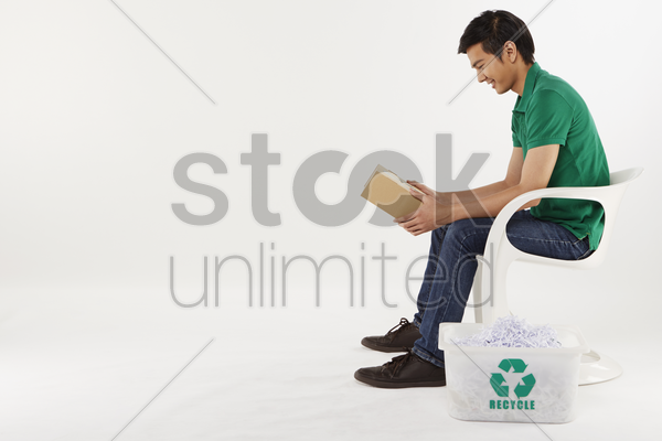 man holding a cardboard box, smiling stock photo