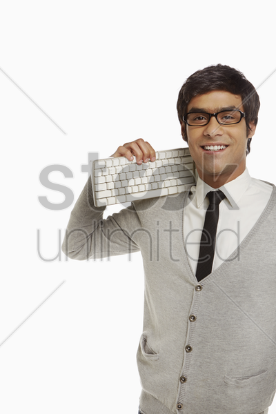 man holding a computer keyboard stock photo
