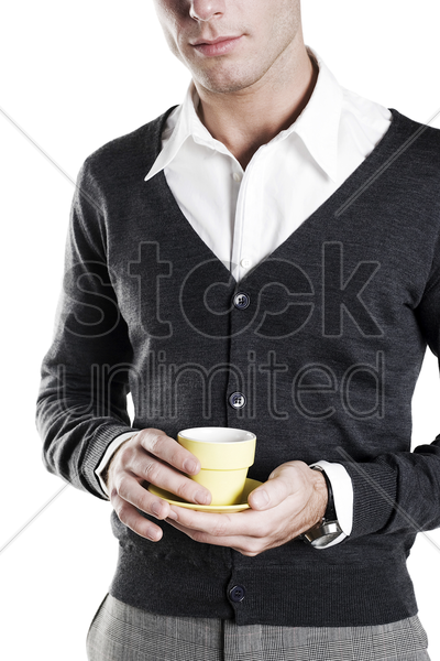man holding a cup of coffee stock photo