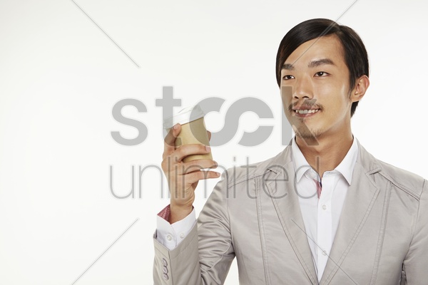 man holding a disposable cup stock photo