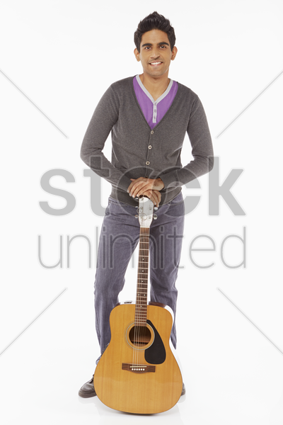 man holding a guitar stock photo