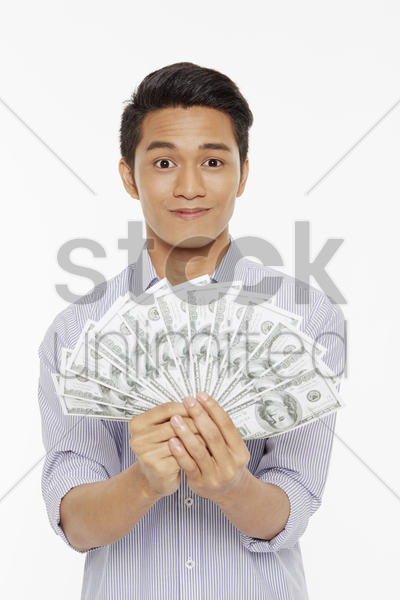 man holding a pile of cash stock photo