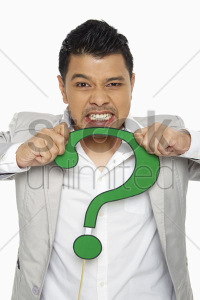 man holding a question mark symbol in anger stock photo