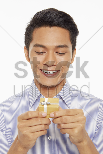 man holding a small gift box stock photo