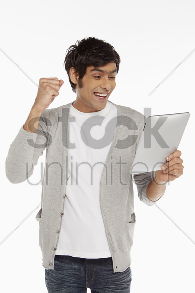 man holding digital tablet, cheering stock photo