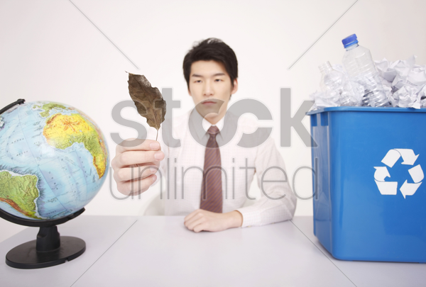 man holding dry leaf stock photo