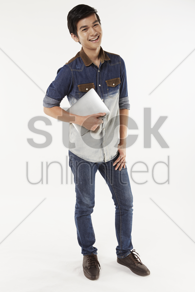 man holding on to a digital tablet stock photo