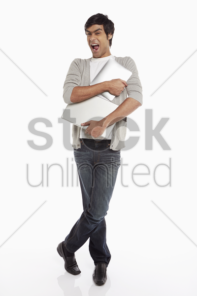 man holding on to the laptop and digital tablet stock photo