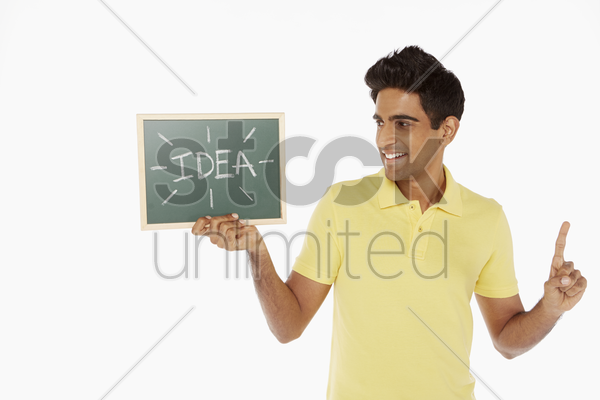 man holding up a blackboard with an 'idea' word on it stock photo