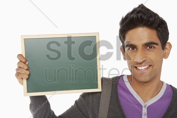 man holding up a blank blackboard stock photo