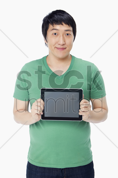 man holding up a digital tablet stock photo