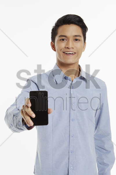 man holding up a mobile phone stock photo