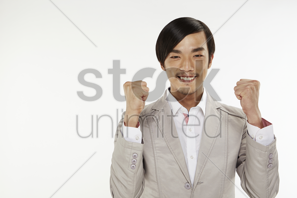 man holding up his fists stock photo