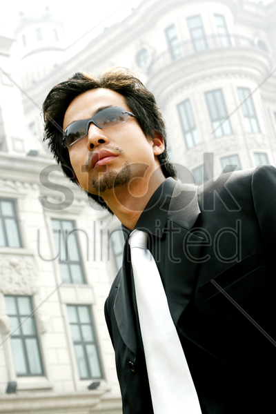 man in business suit wearing sunglass stock photo