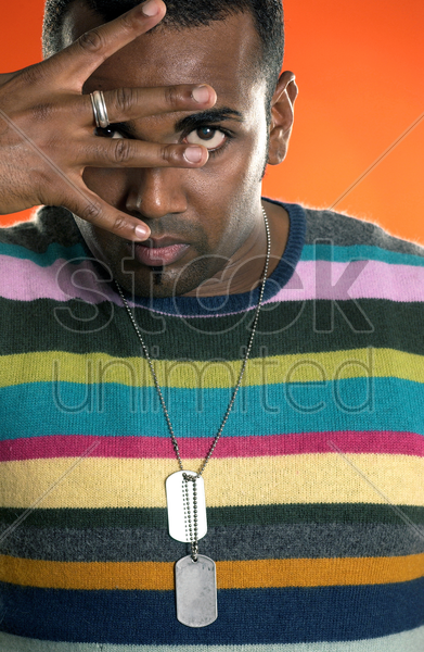 man in colourful shirt showing four fingers stock photo
