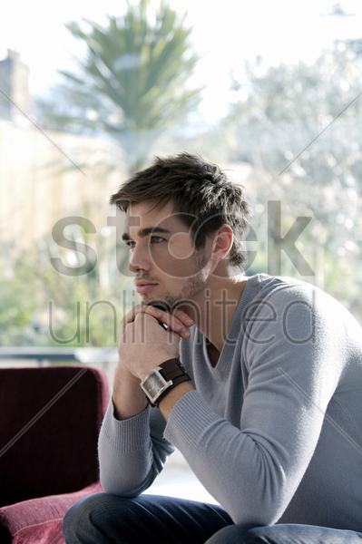 man in deep thought stock photo