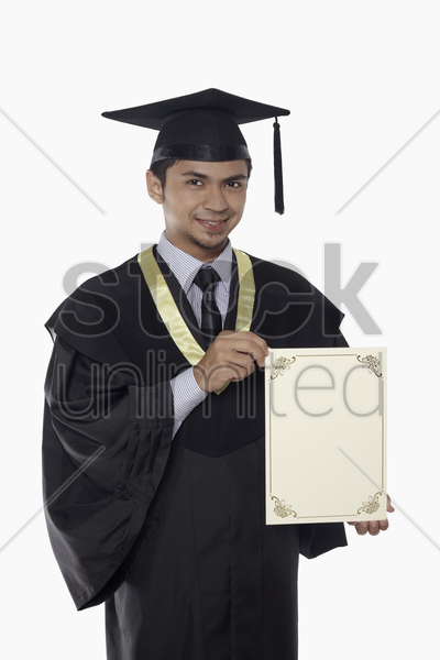 man in graduation robe holding a blank certificate stock photo
