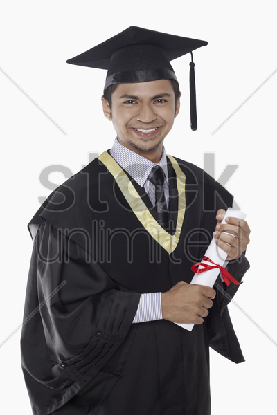 man in graduation robe holding his diploma scroll stock photo