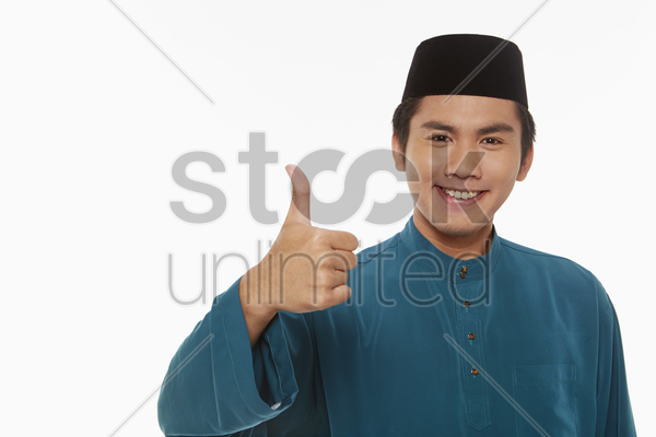 man in traditional clothing giving thumbs up stock photo