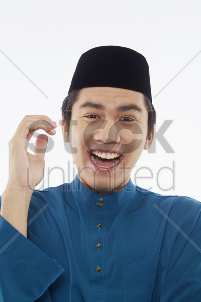 man in traditional clothing laughing stock photo