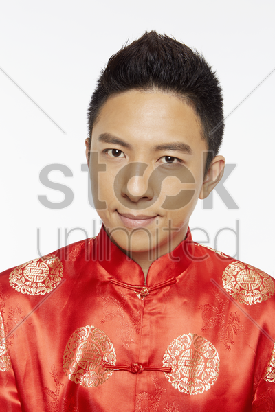 man in traditional clothing looking at the camera stock photo