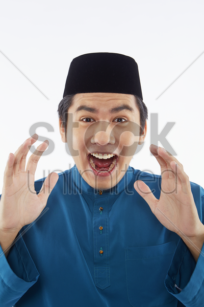 man in traditional clothing looking surprised stock photo