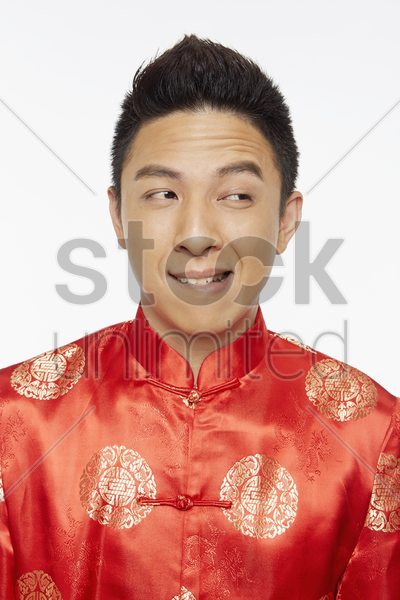 man in traditional clothing making a face stock photo
