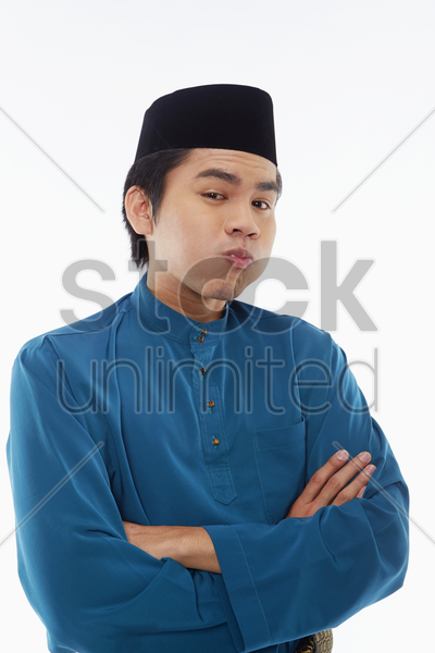 man in traditional clothing making funny faces stock photo
