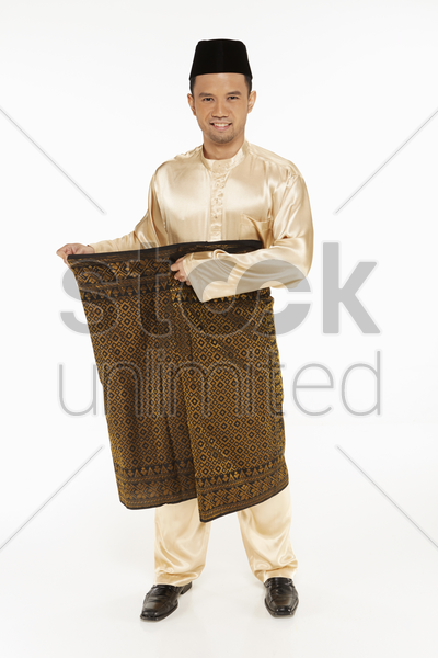 man in traditional clothing outing on his sarong stock photo