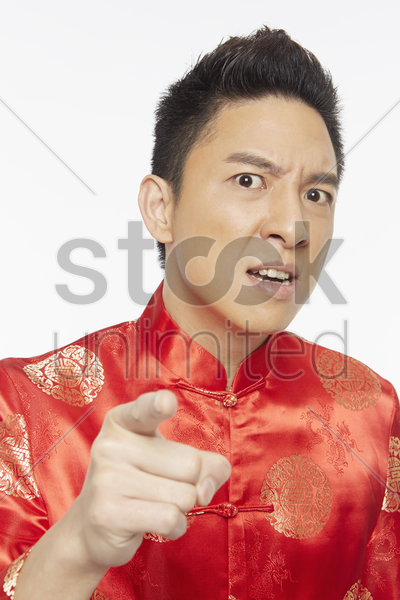 man in traditional clothing pointing at the camera stock photo