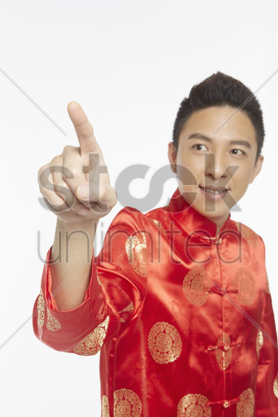 man in traditional clothing pointing to the right stock photo