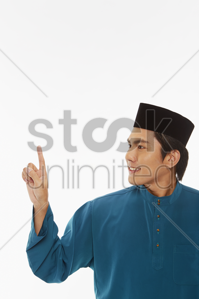 man in traditional clothing showing hand gesture stock photo