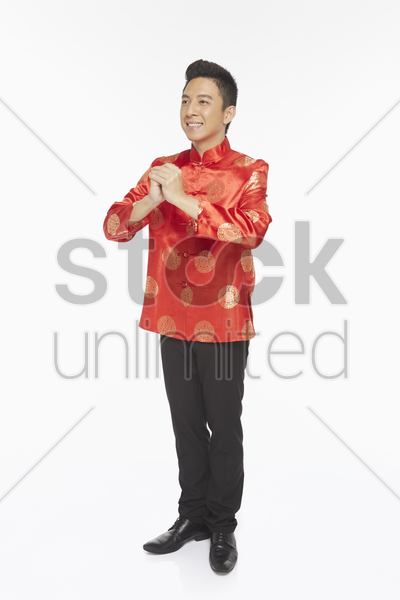 man in traditional clothing showing hand greeting gesture stock photo