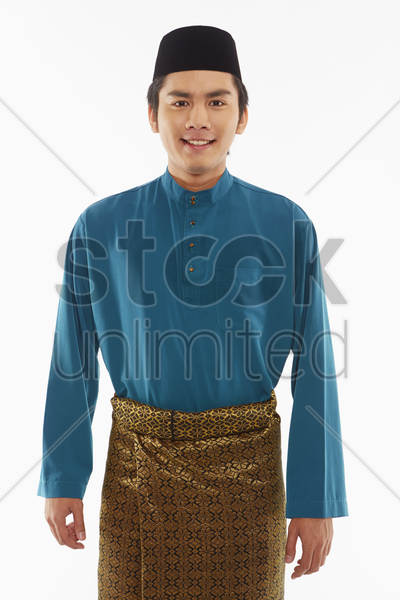 man in traditional clothing smiling at the camera stock photo