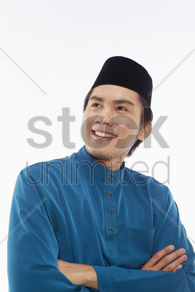 man in traditional clothing smiling stock photo