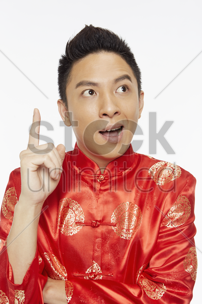 man in traditional clothing with a plan stock photo
